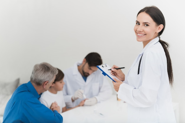 Nurse is recording results of blood sampling. Premium Photo