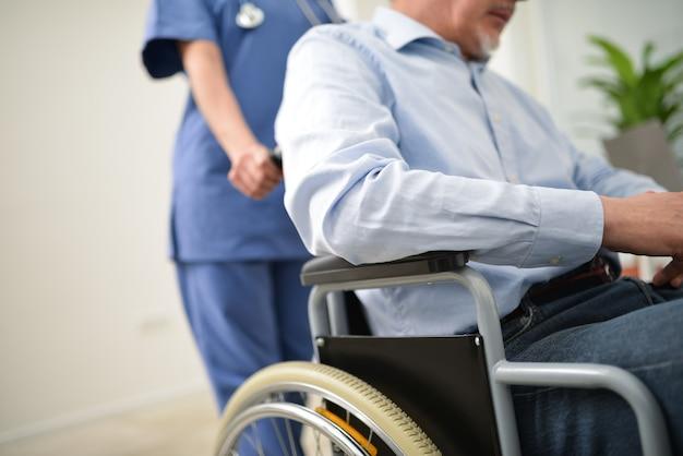 Nurse pushing an injured patient on a wheelchair Premium Photo