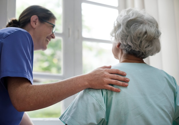 Nurse taking care of an old woman Free Photo