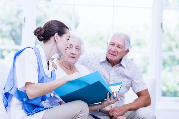 Nurse taking care of sick elderly patients at home Premium Photo