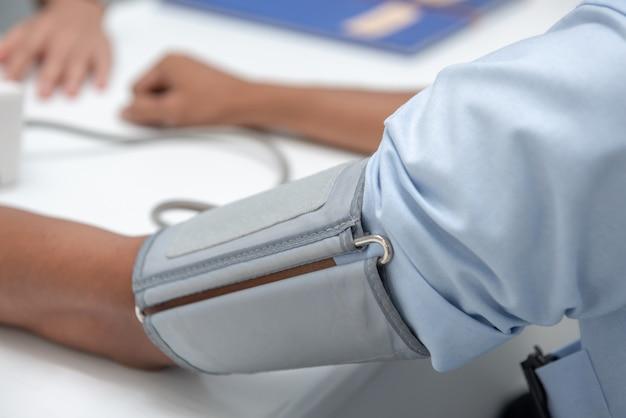 The nurse uses a patient's arm pressure gauge. Premium Photo