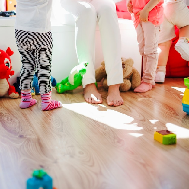 Nurse with children in playroom Free Photo