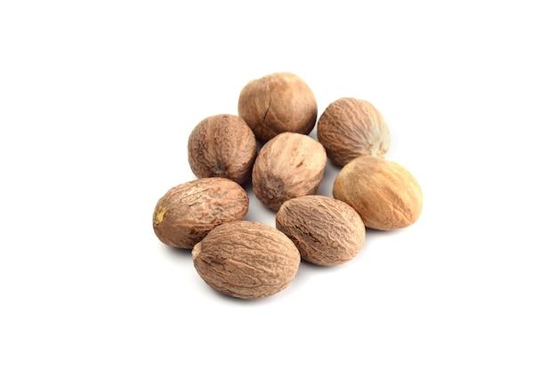 Nutmeg isolated on white surface. close up. Premium Photo