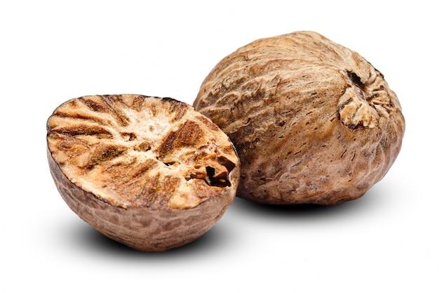 Nutmeg on white table Premium Photo