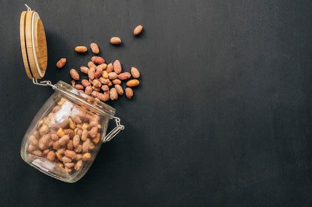 Nuts falling out of glass Free Photo