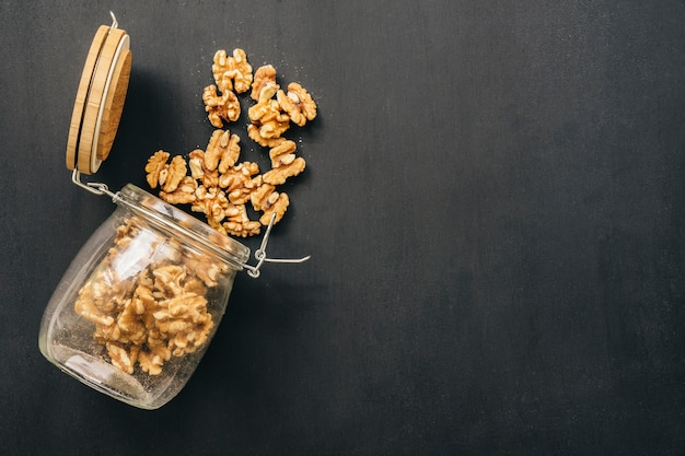 Nuts in glass on chalk surface Free Photo
