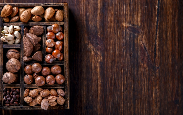 Nuts mixed in a wooden box.assortment Premium Photo