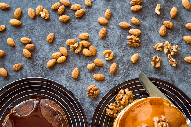 Nuts and pancakes top view Free Photo