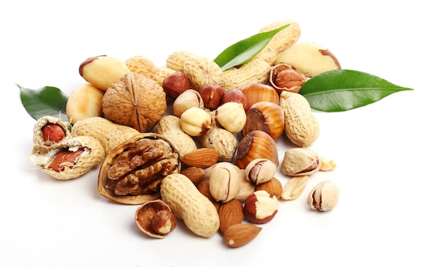 Nuts,walnut, peanuts and almond seeds Free Photo