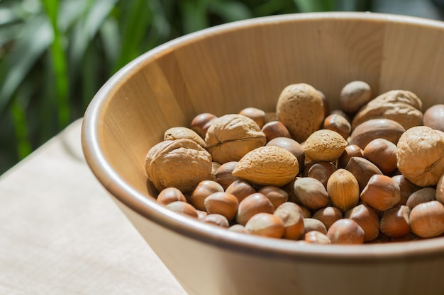 Nuts in wooden bowl. Premium Photo