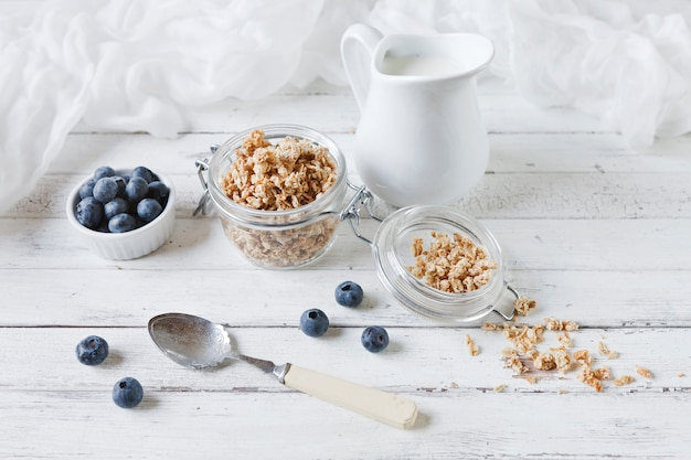 Oat flakes and fresh blueberries with milk. delicious, healthy and useful breakfast Premium Photo