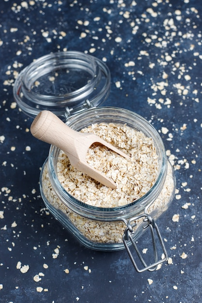 Oat flakes in glass jar. top view. uncooked oatmeal Free Photo