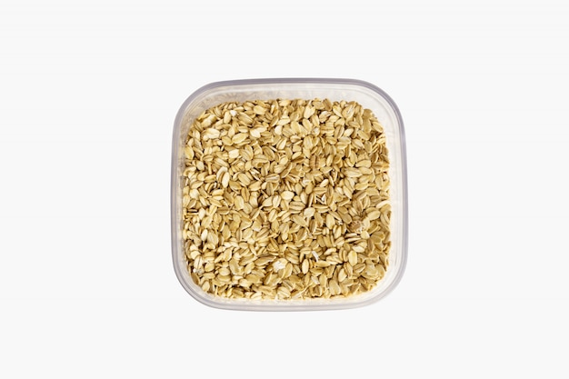 Oat flakes in plastic can isolated on white background Free Photo