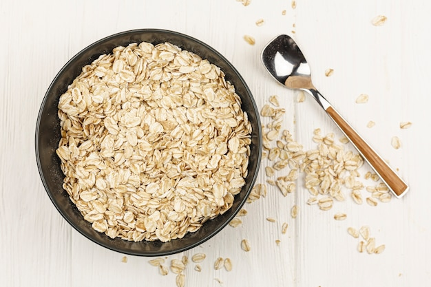 Oatmeal bowl with spoon on the table Free Photo