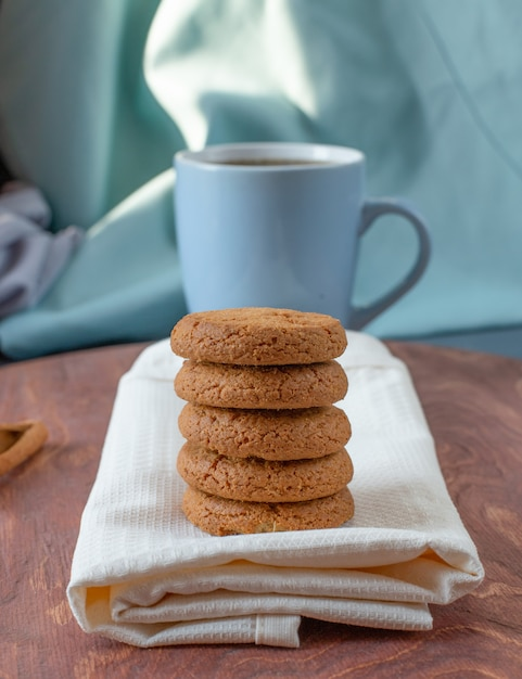 Oatmeal cookies on a piece of towel. Free Photo