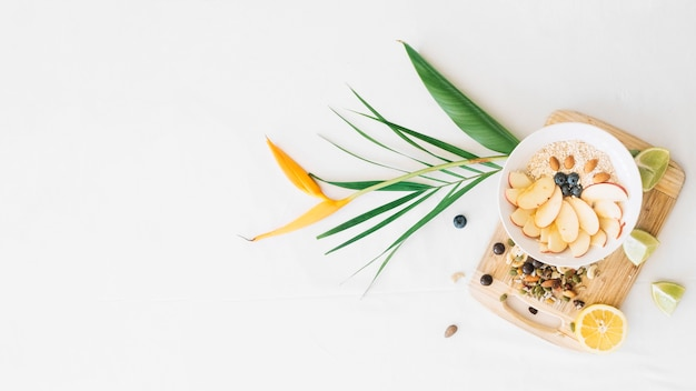 Oatmeal and dryfruits with bird of paradise flower on white background Free Photo