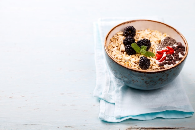 Oatmeal, granola. summer healthy breakfast Premium Photo