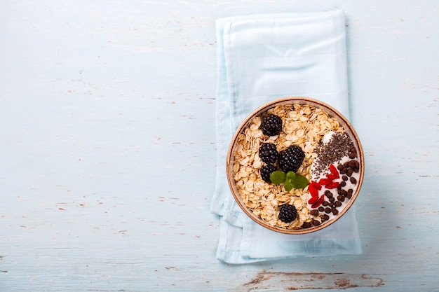 Oatmeal,granola with berries .summer healthy breakfast. Premium Photo