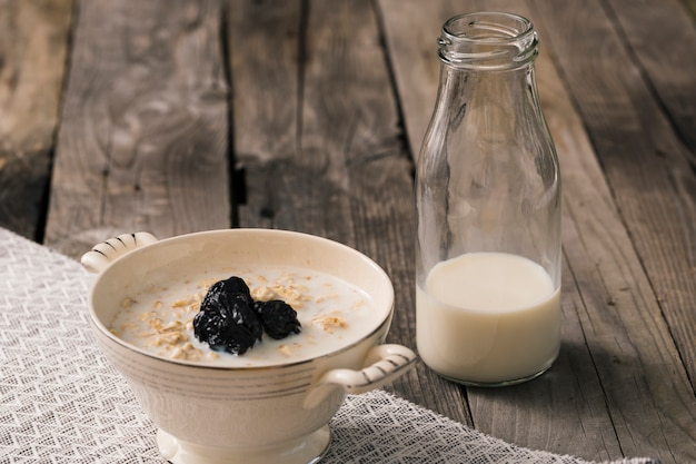Oatmeal Porridge With Bottle Of Milk On The Rustic Table Free Photo