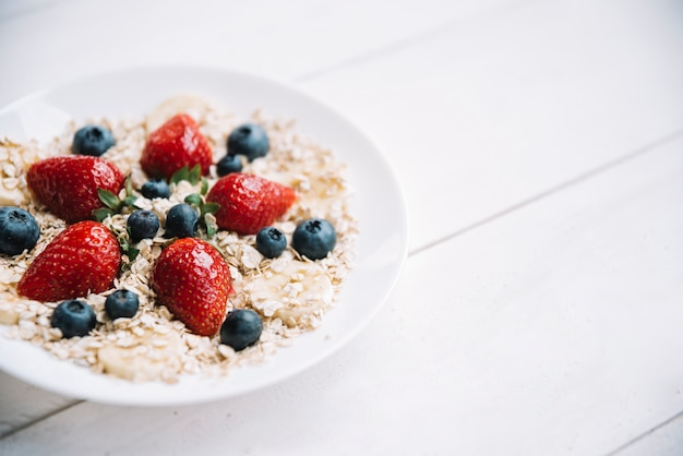 Oatmeal with different berries bowl 23 2148039677
