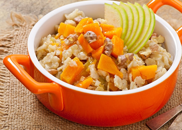 Oatmeal with pumpkin, apples, nuts and honey Free Photo