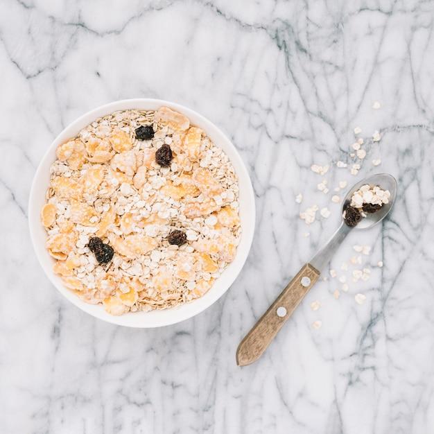 Oatmeal with raisins in big bowl Free Photo