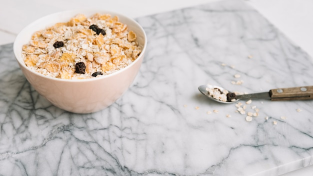 Oatmeal with raisins in bowl on table Free Photo