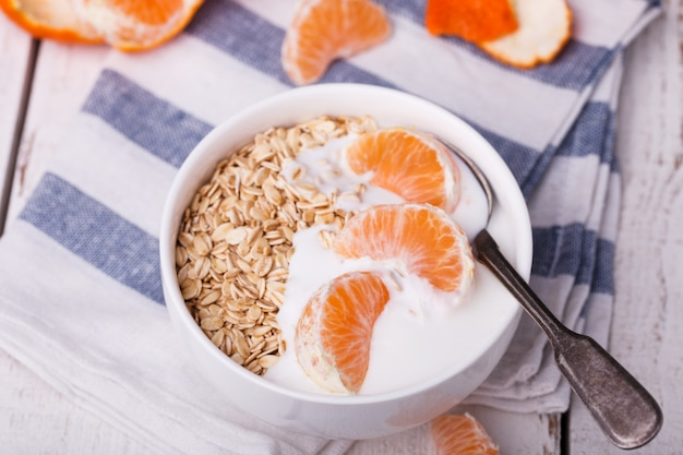 Oatmeal with yogurt and mandarin.healthy breakfast Premium Photo