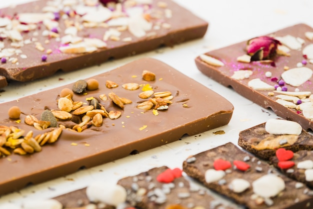 Oats and seeds on chocolate bar Free Photo