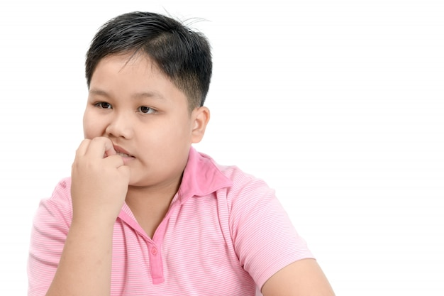Obese fat boy biting nail isolated Premium Photo