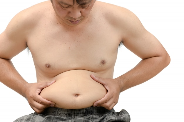 Obese man checking out his weight isolated Premium Photo