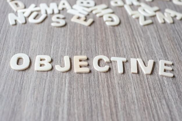 Objective word of wooden alphabet letters. business and idea concept Premium Photo