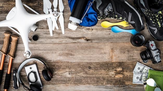 Objects for adventure trip - quadcopter, trekking pole, trekking shoes Premium Photo