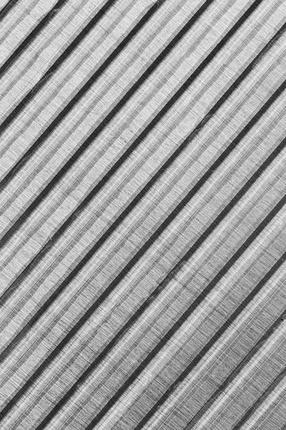斜めの縞模様の金属材料の背景 Premium写真