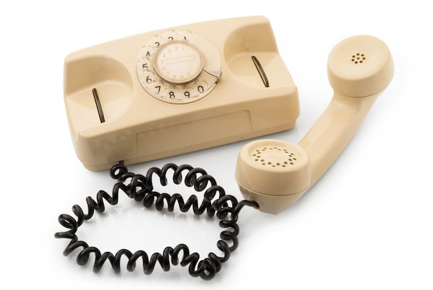 Obsolete phone on white background Premium Photo
