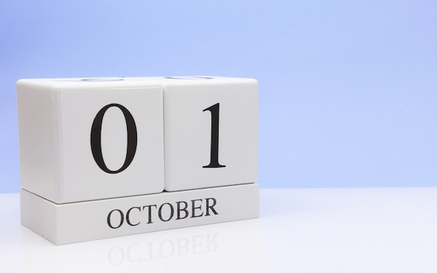 October 01st. day 1 of month, daily calendar on white table Premium Photo