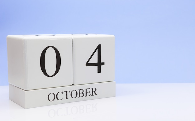 October 04st. day 4 of month, daily calendar on white table Premium Photo