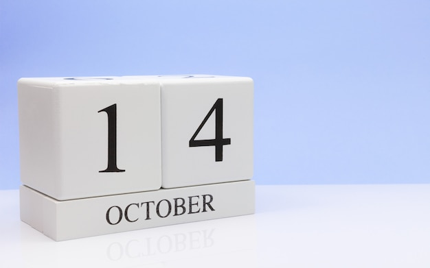 October 14st. day 14 of month, daily calendar on white table Premium Photo