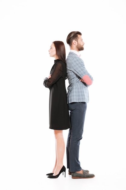 Offended serious loving couple standing isolated Free Photo