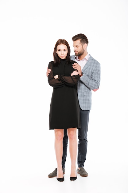 Offended young loving couple swear isolated Free Photo