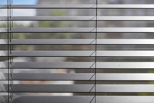 Office blinds. modern wooden jalousie. office meeting room lighting range control. Premium Photo