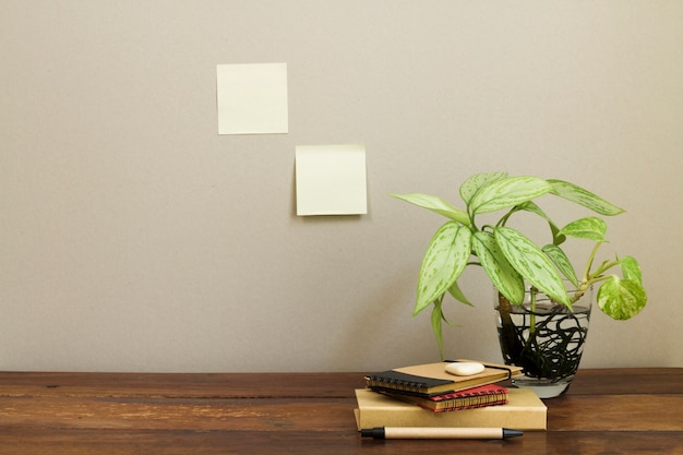Office composition with potted plant Free Photo