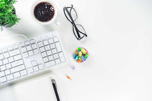 Office creative desk with supplies and coffee cup Premium Photo