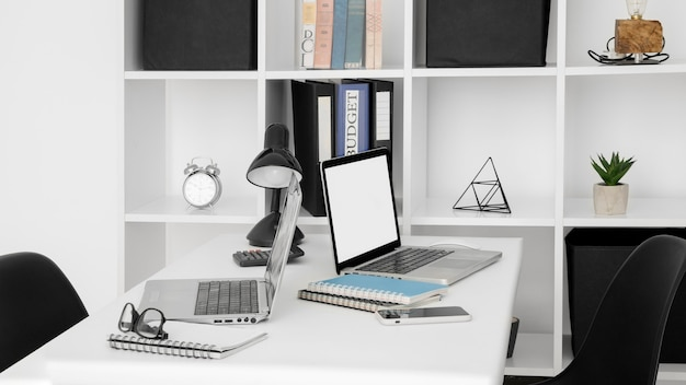 Office desk surface with two laptops Free Photo