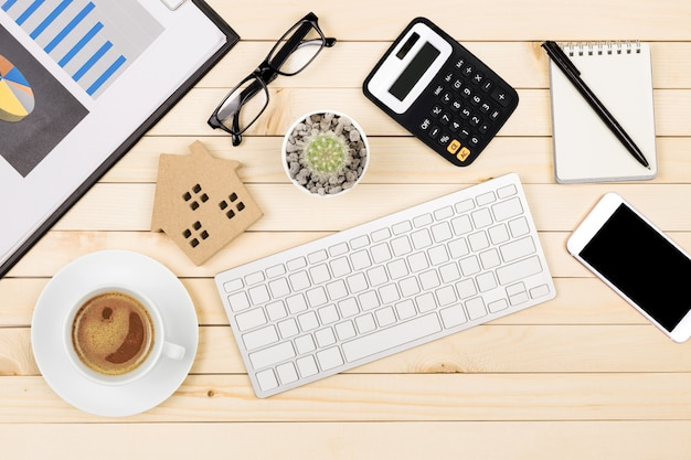 Office desk table of modern workplace with laptop on wooden table Premium Photo