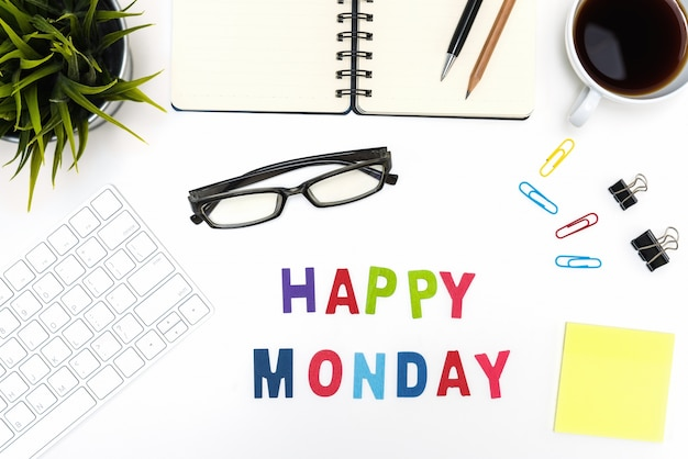 Office desk table with happy monday word Free Photo