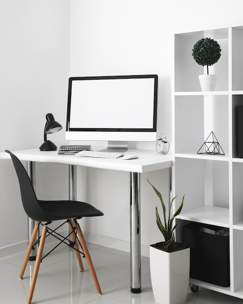 Office desk with computer and desk chair Free Photo