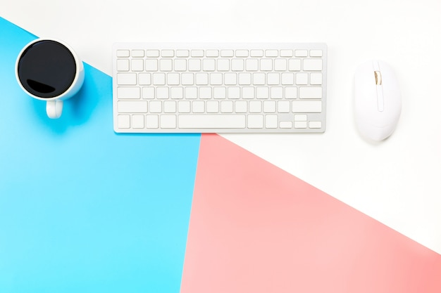 Office desk with keyboard, mouse and coffee Premium Photo