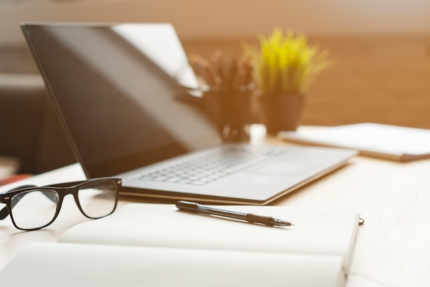 Office desktop with laptop and analytics Free Photo