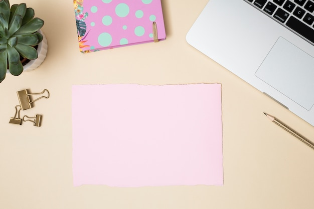 Office desktop with a laptop and other elements Free Photo
